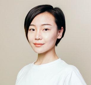 Ruijia Wang in a white shirt smiling