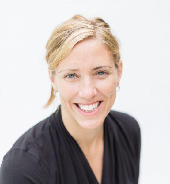 Jane Willenbring smiling at camera wearing a black shirt