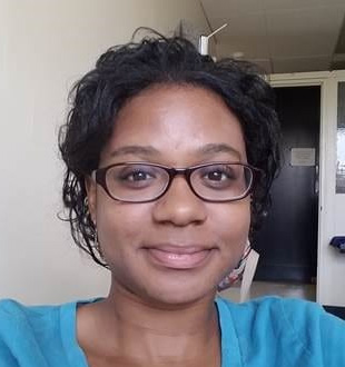Melissa Sims wearing a blue shirt and glasses