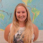 Lauren Brooke Nenow standing in front of a map