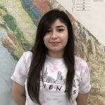 Sofia Tovar standing in front of a map
