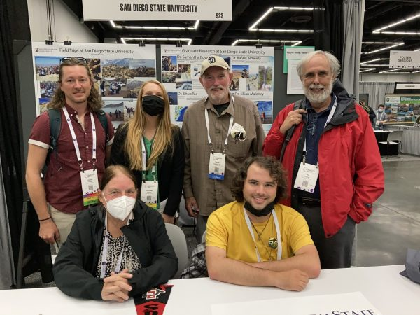 Students and faculty in the booth at GSA 2021